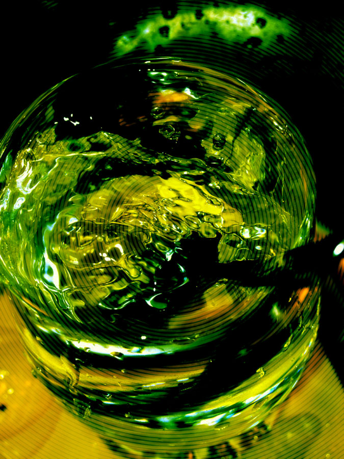 glass of water and spoon 2001 photography yellow effect